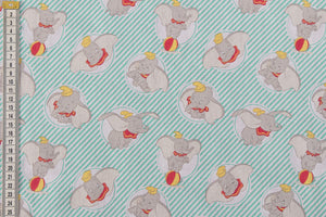 Disney Dumbo Fabric by Camelot Fabrics. Pale Green Stripes.