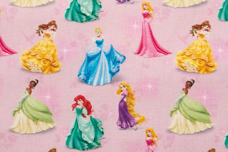 Mini Disney Princesses Fabric Design 2 - Pink Background with Belle, Ariel, Rapunzel, Cinderella, Tiana and Aurora. 100% Cotton.