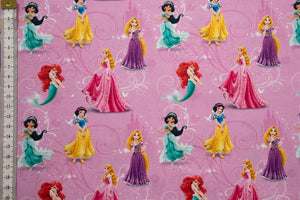 Mini Disney Princesses Fabric Design 1 - Pink Background with Jasmine, Ariel, Rapunzel, Sleeping Beauty and Snow White. 100% Cotton