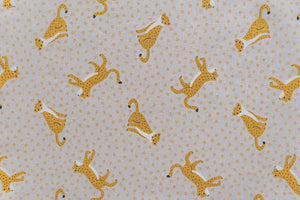 Leopard Journey Fabric - Beige Background, Mustard Colour Leopards. Mixed Cotton, Suitable for Interiors and Crafts.