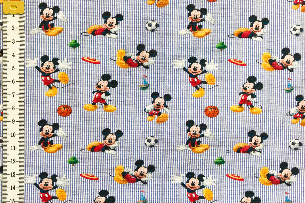 Disney Sporty Mickey Mouse Fabric - Background of Blue and White Stripes. 100% Cotton.