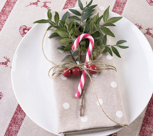 Small White Spots on Beige Background - Linen Look Fabric. Christmas Table Setting Scene