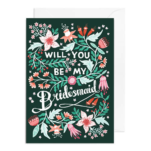 A dark green greetings card with green and pink florals. It's captioned with will you be my bridesmaid.