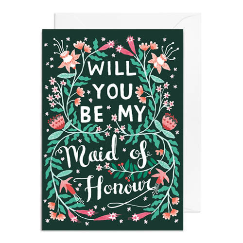 A dark green greetings card with green and pink florals. It's captioned with will you be my maid of honour.