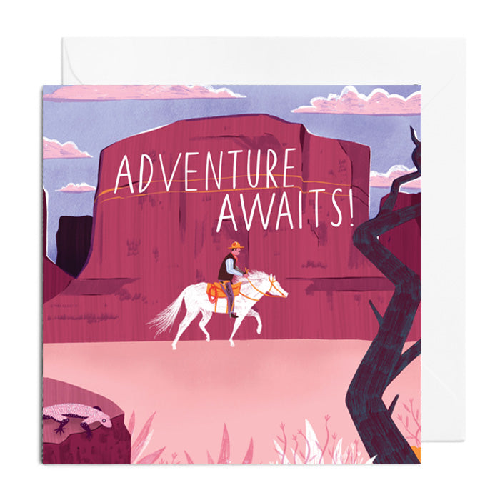 A greetings card featuring a cowboy on a horse in the desert, captioned with Adventure Awaits!