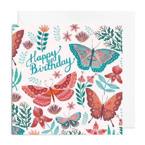 A pink and green greetings card featuring butterflies and florals. It's captioned with Happy Birthday!