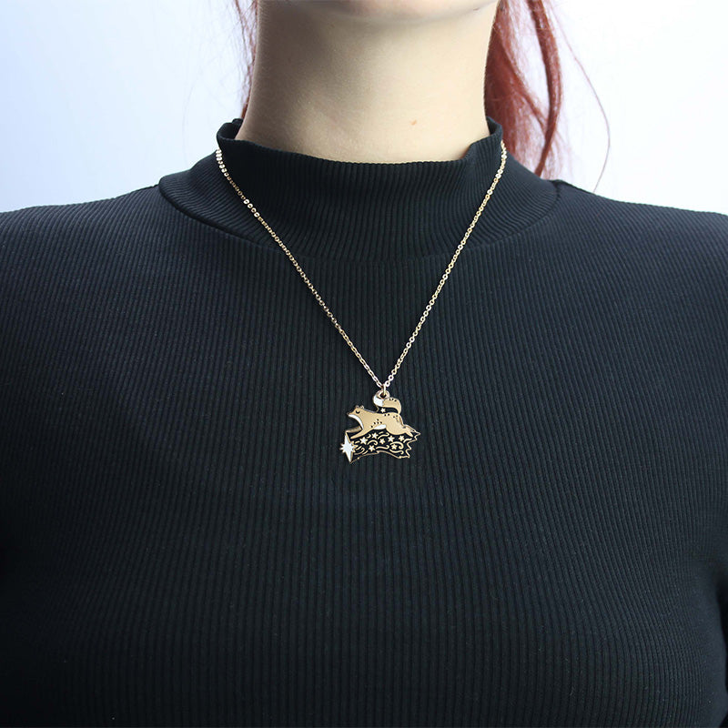 A woman wearing the fox necklace.