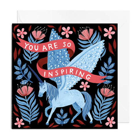 A black greetings card featuring a blue pegasus with blue and pink florals. It's captioned with YOU ARE SO INSPIRING.