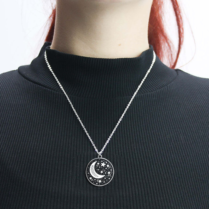 A woman wearing the moon and stars necklace.