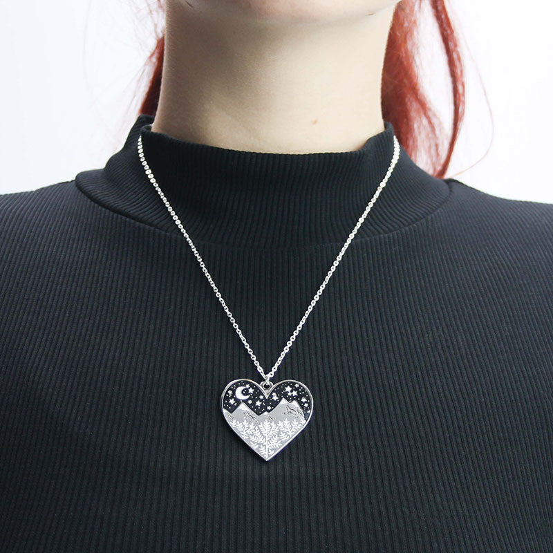 A woman wearing the heart necklace.