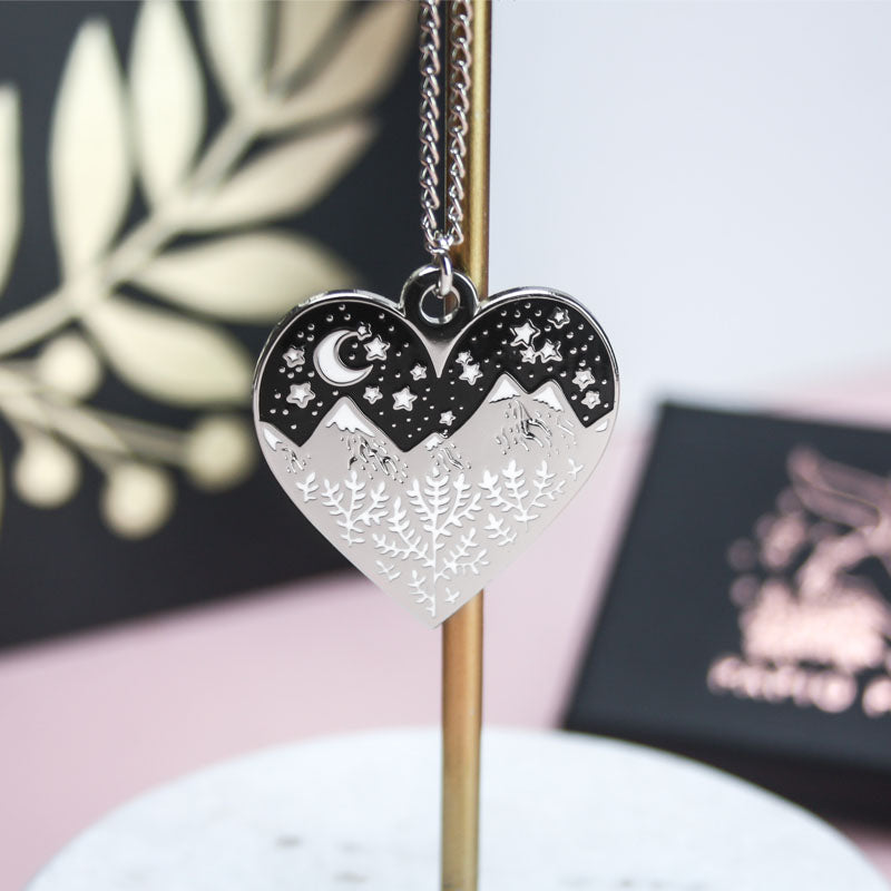 The heart necklace hanging on a jewellery stand.