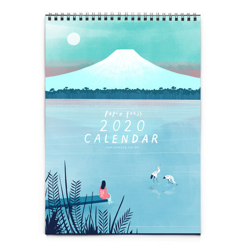 Papio press 2020 calendar cover, featuring a woman dipping her toe into a lake in front of Mt. Fuji. There are two cranes resting in the lake.
