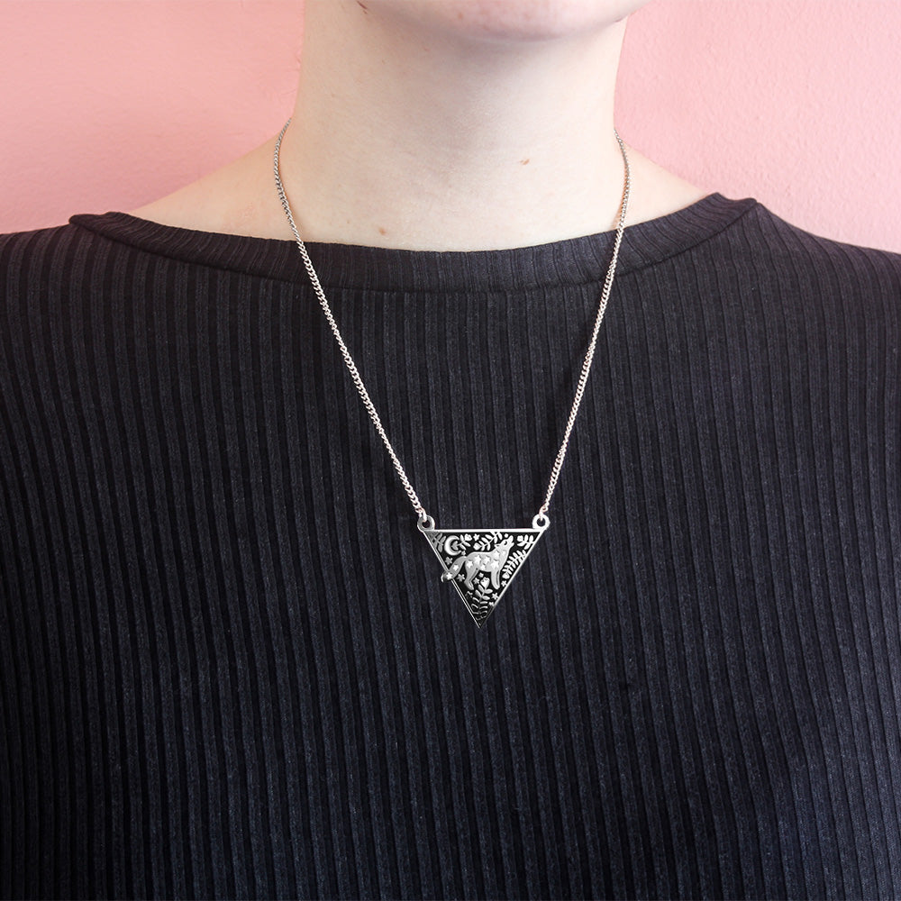 A woman wearing the wolf necklace.