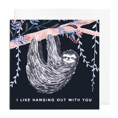 A black greetings card featuring a hanging sloth on a pink branch. It's captioned with I LIKE HANGING OUT WITH YOU.