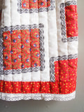 Red and white quilted pattern maxi skirt