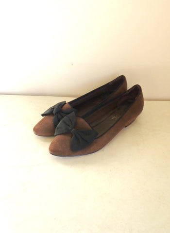 Brown leather flats with a black bow