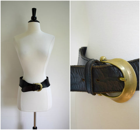 Sturdy black leather waist belt with large brass buckle