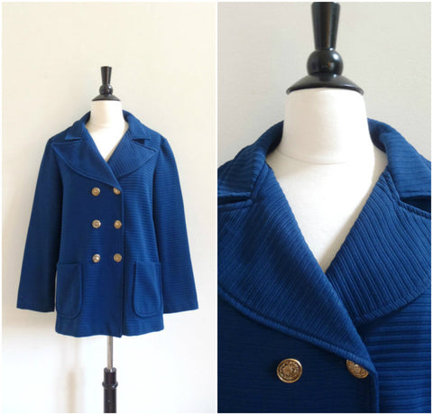 Blue ribbed double breasted jacket with gold buttons
