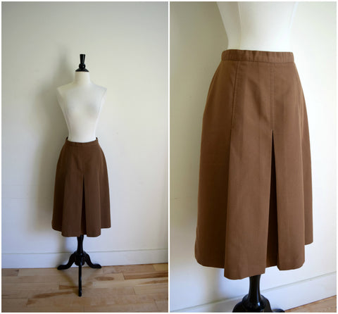 Brown midi skirt with gored pleats