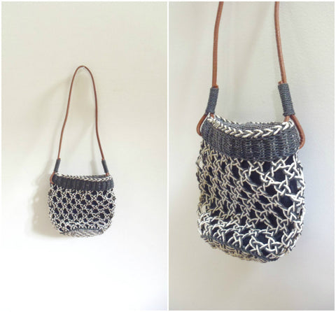 Black and white straw bag with leather handle strap