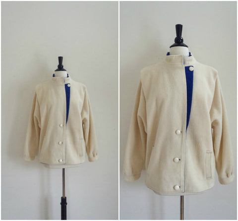 White wool assymetrical coat with royal blue details
