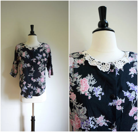 Black floral blouse with delicate lace collar