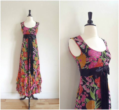 Floral sleeveless maxi dress with satin bow waist detail
