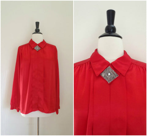 Red silky blouse with silver beaded rhinestone neck detail