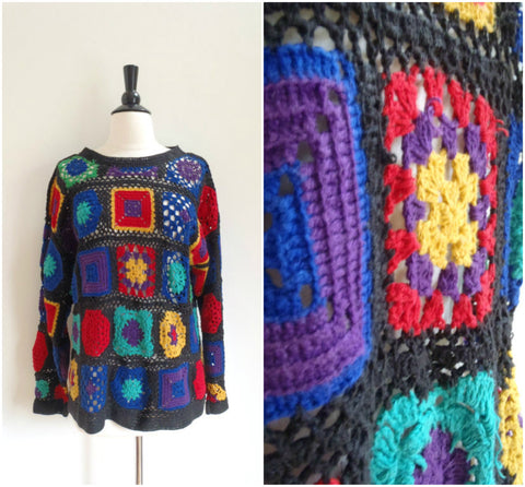 Rainbow and black open weave sweater
