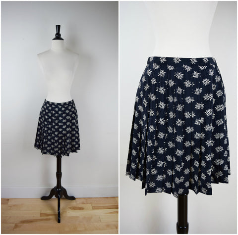 Black and tan print accordion pleat mini skirt