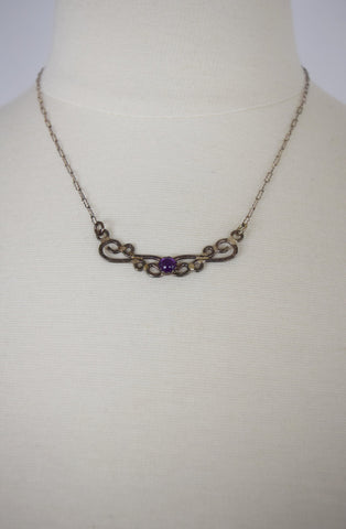 Sterling silver and purple stone swirl necklace
