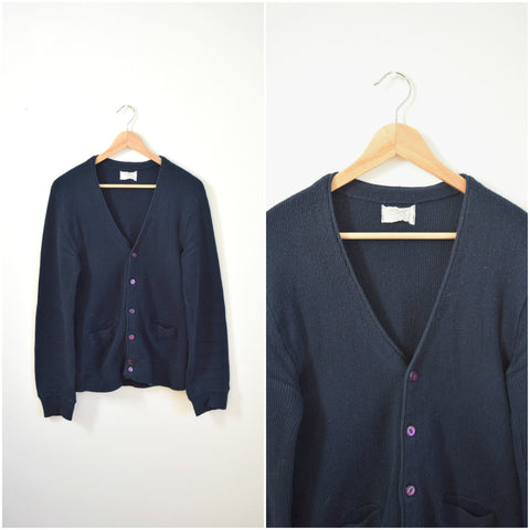 Men's navy blue knit cardigan sweater with purple buttons