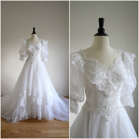Romantic layered lace wedding gown with sheer puffy sleeves & matching veil