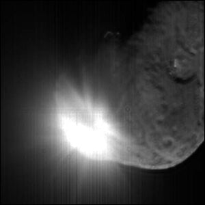 The fireworks were spectacular at 1:52 a.m. EDT July 4, when the Deep Impact probe smashed Comet Tempel 1. The well-targeted impactor was vaporized as it blasted out a cloud of material, seen here 13 seconds after impact Photo courtesy of the University of Maryland, JPL-Caltech, NASA