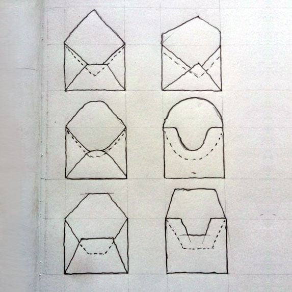 Photo of sketches for the overall shape of the custom leather stationary envelope.