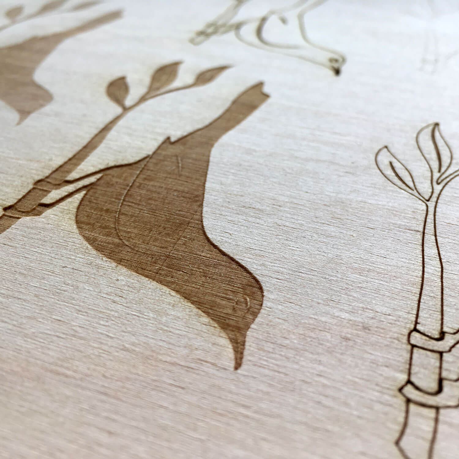 SML created custom, laser etched branded tabletops for JuneBaby of Seattle