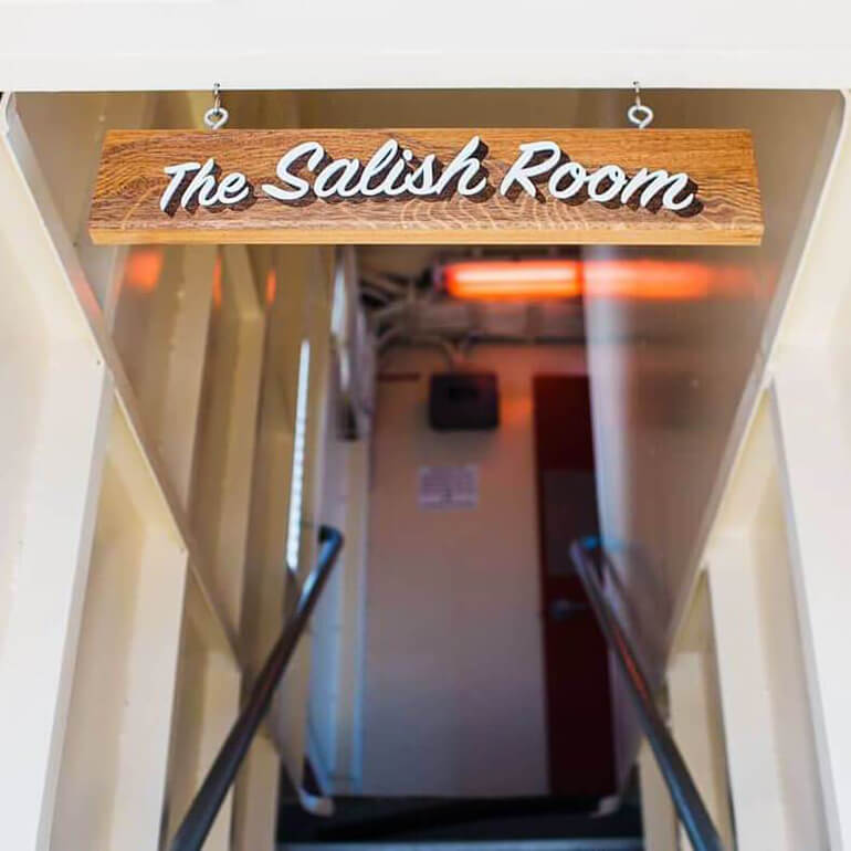 SML created a custom laser cut and painted sign for The Salish Room on the Hiyu, Seattle