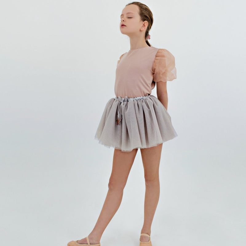 10 year old dancing in the grey sparkle gold glitter dot and gold stars tutu by Mimi and Lula and Crane and Kind