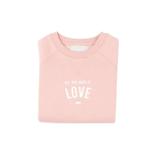 ALL YOU NEED IS LOVE BLUSH PINK SWEASHIRT WITH WHITE FONT AT CRANE AND KIND BY BOB AND BLOSSOM