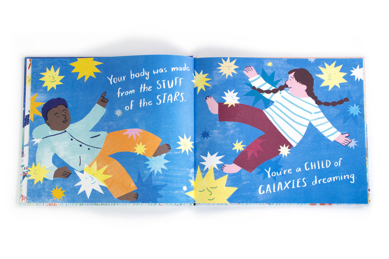 the back cover fo child of galaxies hard back book at crane and kind show two children dreaming in a night sky of stars