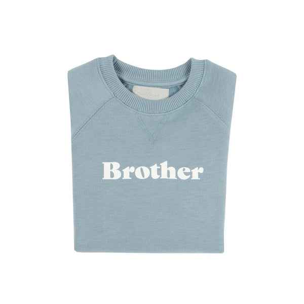 sky blue super soft relaxed sweatshirt featuring brother in white print on the front by bob and blossom at crane and kind