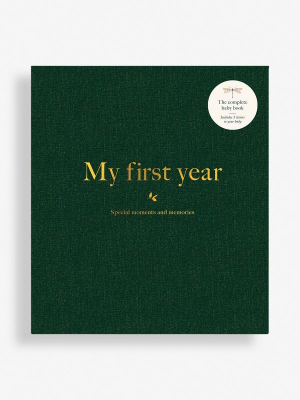 my first year complete baby book to document special moments and memories in bottle green linen fabric with gold detailing by Milestone at Crane and Kind