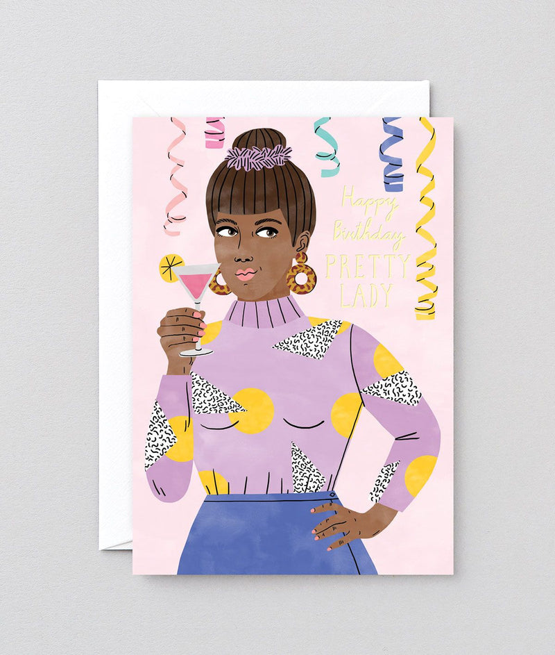 a black lady in a violet sweater drinks a cocktail in a party with gold foil lettering spelling out happy birthday pretty lady at Crane and Kind