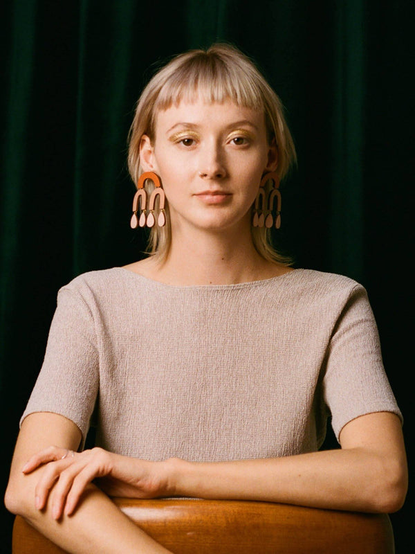 Model wearing the Waterfall Earrings in Blush by Wolf and Moon at Crane and Kind