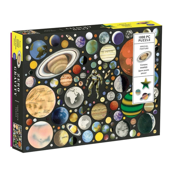 zero gravity 100 piece puzzle at Crane and Kind shows lots of planets and a spaceman against a black background