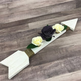 Distressed chalk painted wood arrow with plum purple and ivory cream paper flowers and twine wrapped