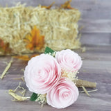 large Boutonniere made with blush paper flower peonies with baby's breath, green leaves, and a burlap stem