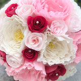 close-up of fuchsia, pink, and ivory paper flower bouquet