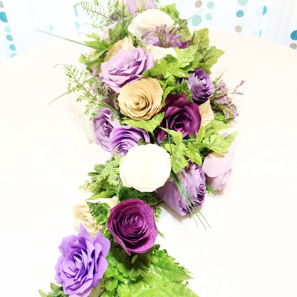 Table runner in purples and white paper flowers