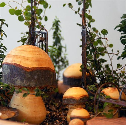 hand carved wooden toadstools